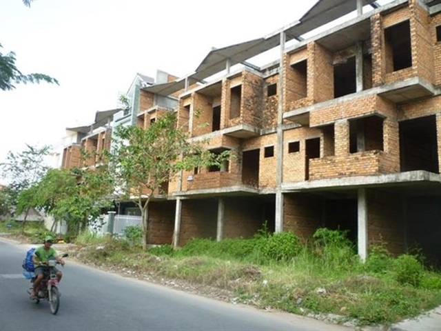 Listed real estate firms inventories surge industry says red tape hits development