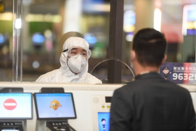 China reports 20 new virus cases jump in imported infections