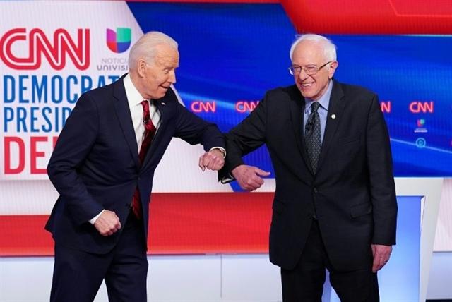 Biden Sanders attack Trump at debate under shadow of virus