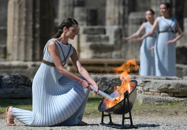 Japan welcomes Olympic flame as doubts swirl over Games