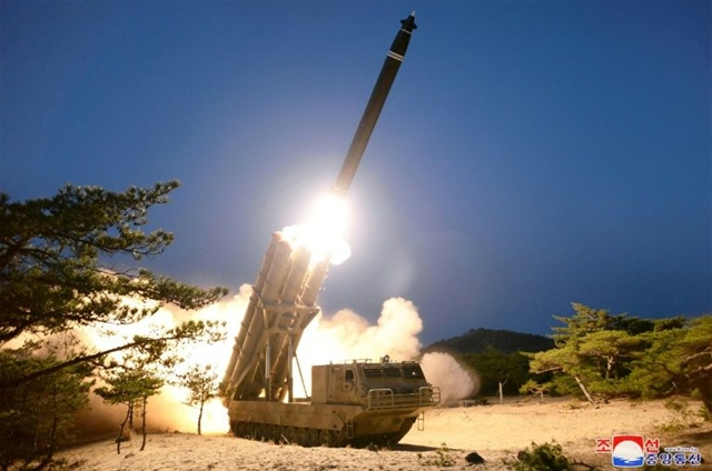 North Korea says tested super-large rocket launchers