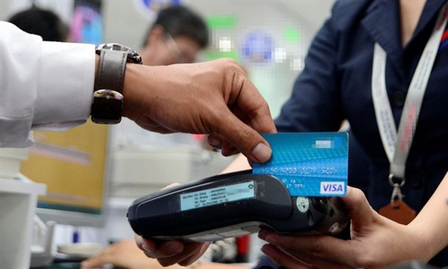 Electronic fund transfer fees to be cut by at least 50 per cent