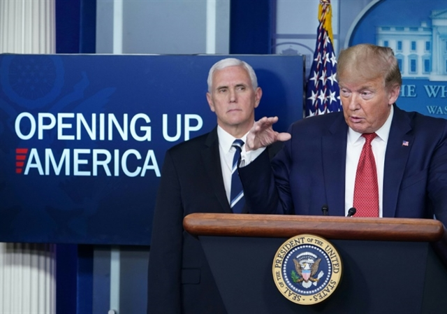 Trump lays out gradual reopening of US as China faces virus fire