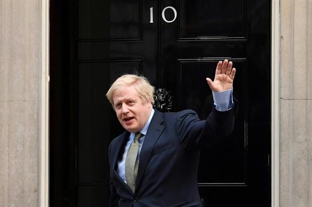 PM Johnson back to work as UK virus problems mount