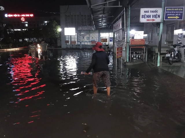 Weekend downpour floods several areas in HCM City