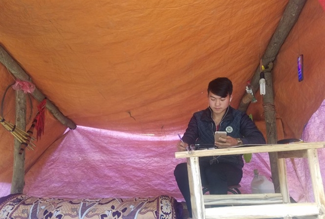 Ethnic minority student builds tent to study online