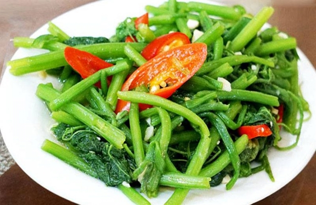 Simple but delicious: stir fried pumpkin buds with garlic