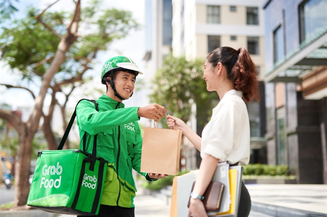 Grab Food takes biggest bite of food delivery in Việt Nam: survey