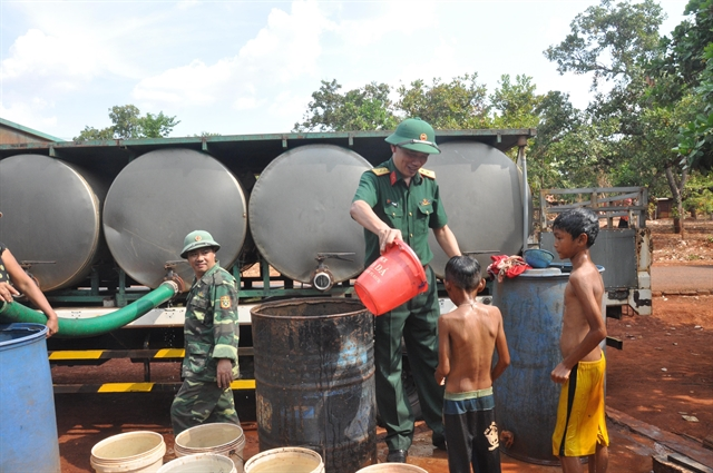 Soldiers share water with local people in Gia Lai Province