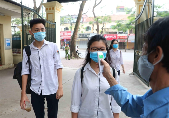 Hà Nội students back to school after prolonged COVID-19 break