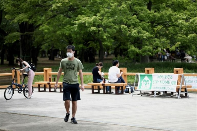 Japan set to extend virus emergency to May 31