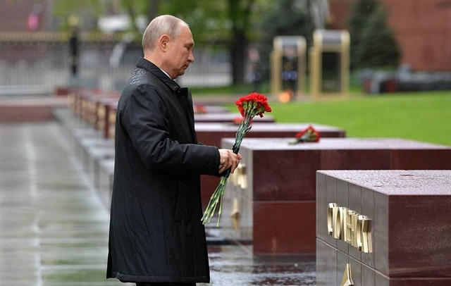 Putin calls for invincible unity as Russians mark Victory Day on lockdown