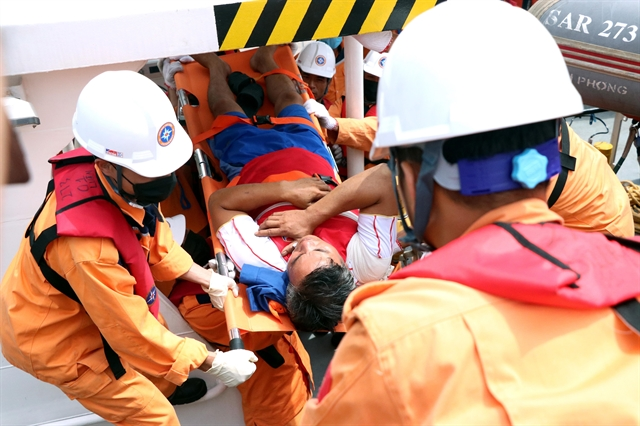 Two crew members saved four remain missing in ship collision