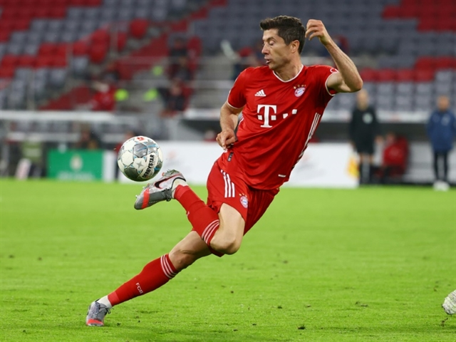 Lewandowski fires weary Bayern into German Cup final in double bid