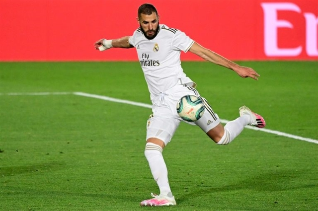Benzema and Asensio volleys fire Madrid to Valencia victory
