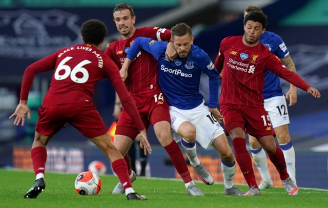 Liverpools title march delayed by Everton stalemate Chelsea sink Villa
