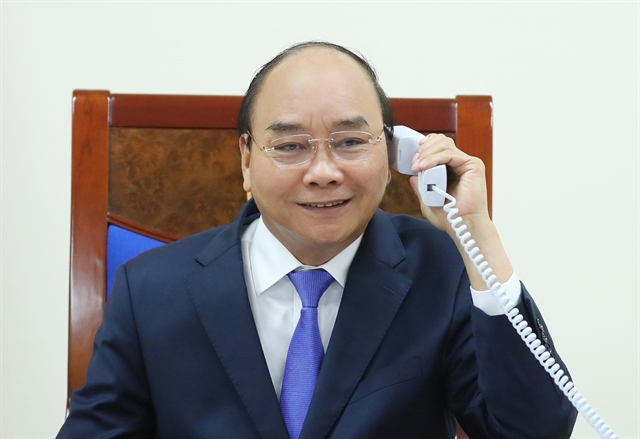 PMs of Việt Nam and Malaysia discuss issues through phone