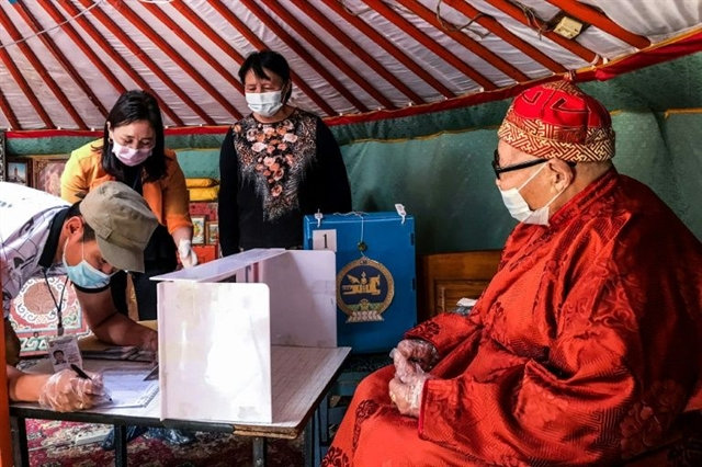 Mongolians vote in shadow of coronavirus