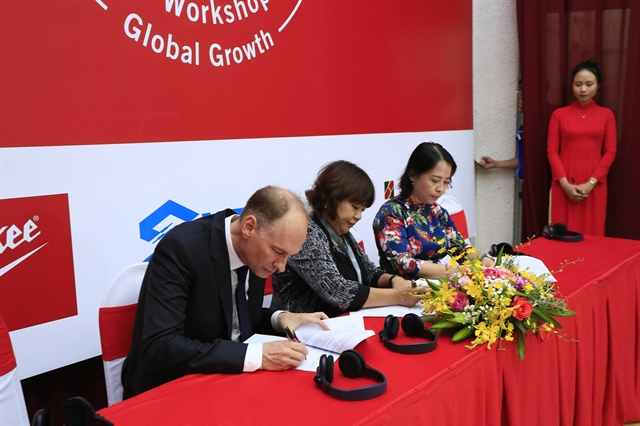 Deals signed to promote links between local supporting industries global supply chain