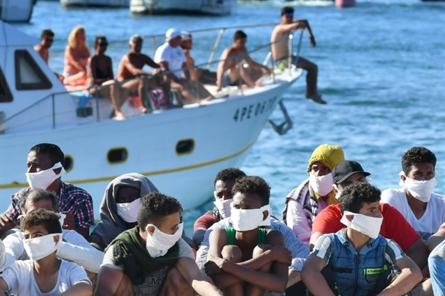 Italy warns of migrant strain as virus repercussions felt
