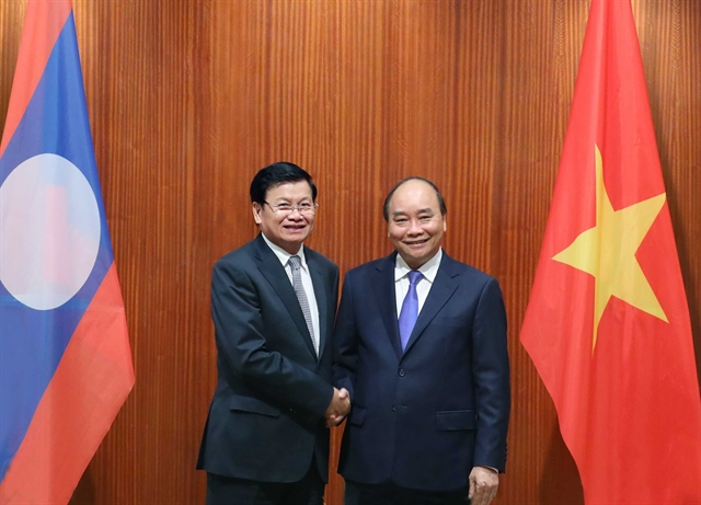 Việt Nam and Laos share post-COVID-19 recovery experience