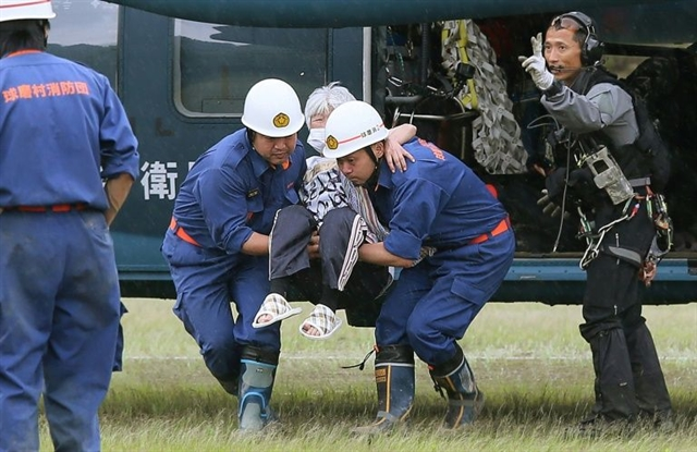 Race against time in Japan floods 50 feared dead