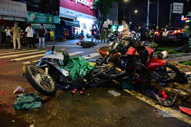Car hits 8 motorbikes injuring 10 people in HCM City