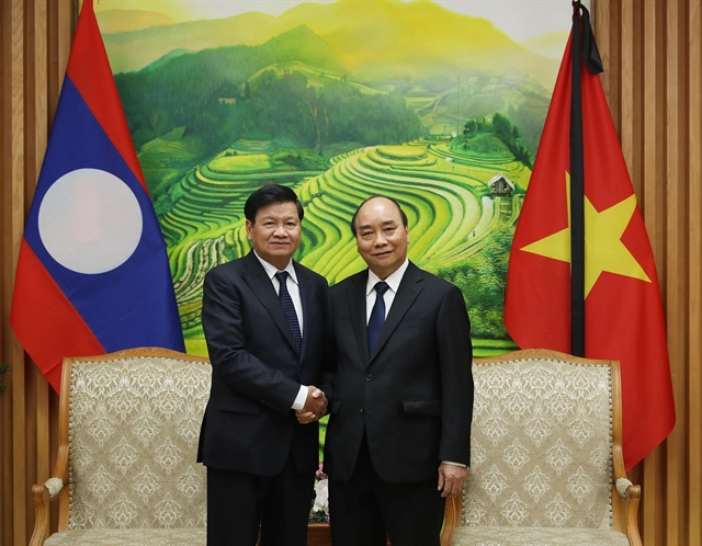 PM Phúc hosts Lao counterpart