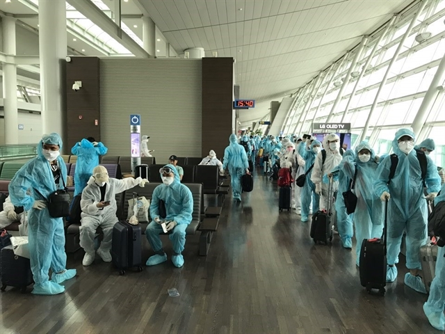 Hundreds more Vietnamese citizens flown home from abroad