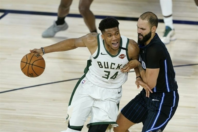 Bucks hold off Magic for NBA series lead Heat close out Pacers