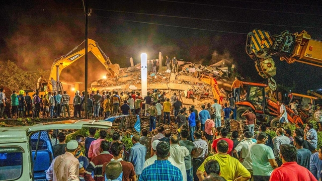 One dead scores feared trapped in India building collapse
