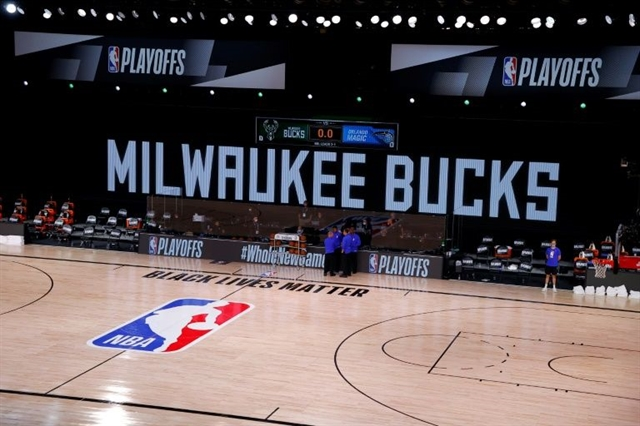 NBA halts playoffs after Bucks lead shooting boycott