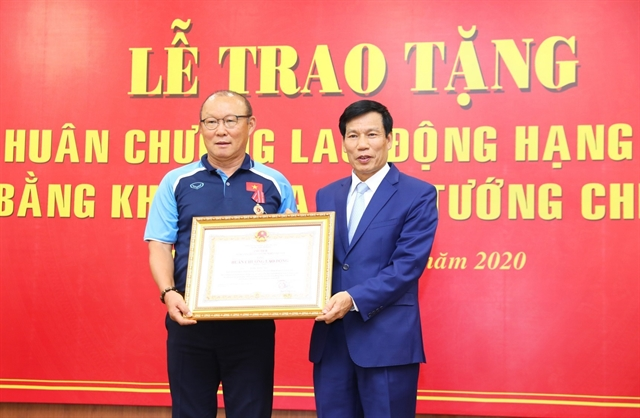 Coach Park honoured with second-class labour medal