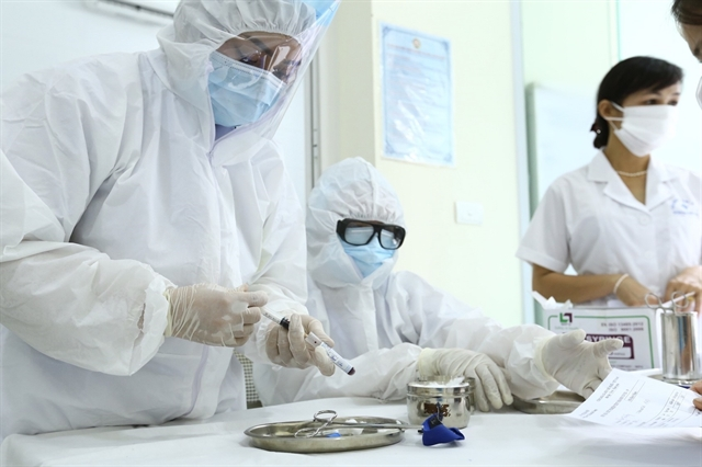 Hà Nội to test 50000 people using PCR diagnostics fine non-mask wearers