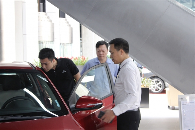 Registration fee cut does little to revive auto market