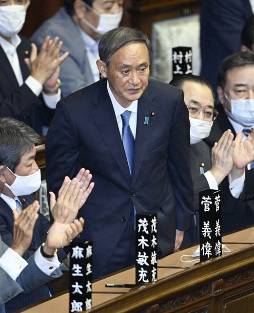 Suga elected Japan PM amid virus economic woes