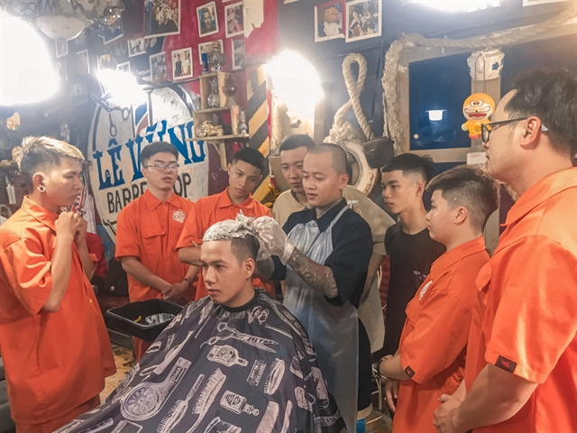 Barbers trim the cost of hair cuts for people in Mekong Delta