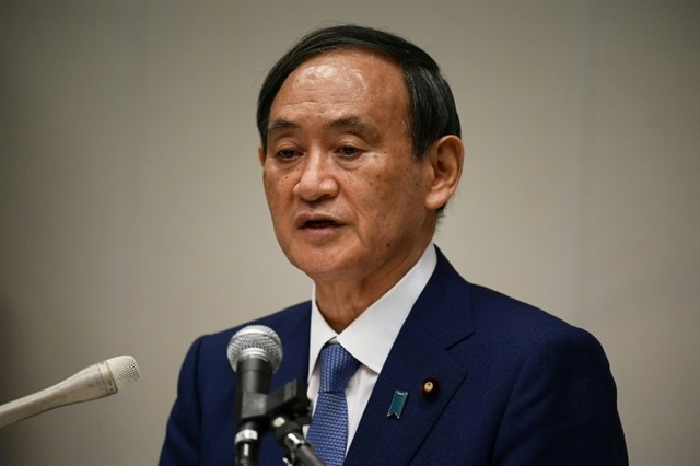 Suga announces LDP leadership bid vows to continue Abenomics