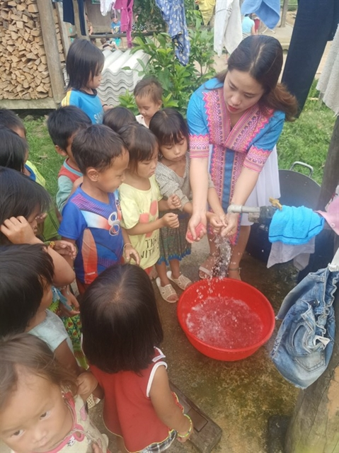 Ethnic teacher volunteers to in remote area