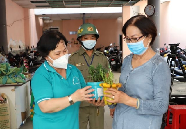 HCM Citys downtown district encourages green living by exchanging necessities for waste