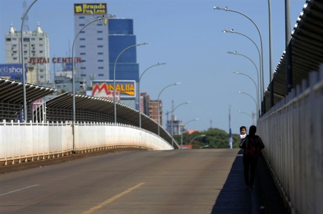 World News Day: In Brazil grappling with loss when bridges - and borders - close