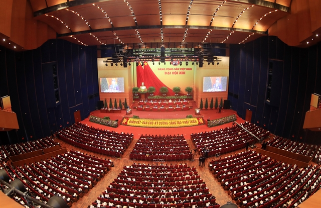 Draft documents on Party building and national development debated at 13th Congress