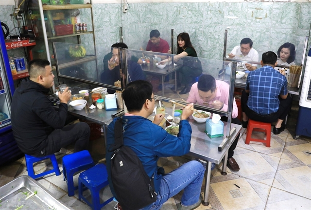 Dine-in services and public transport re-open in Hà Nội