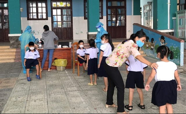 Students in Thạnh An Commune return toschool