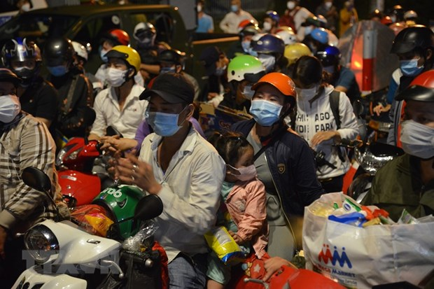 Mekong Delta provinceswant15-day suspension forpeople returningfrom COVID-19 hit localities