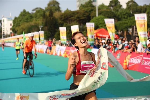 Thanh and Lệ triumph at Tiền Phong Marathon