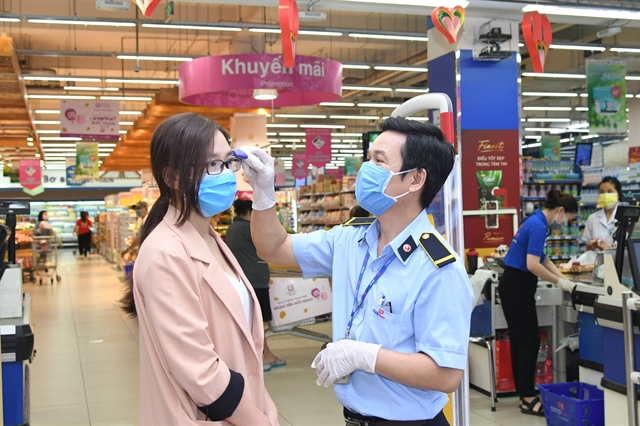 Saigon Co.op increases stocks of essential goods takes COVID precautions