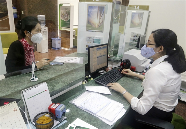 Credit institutions asked to tighten loansin overheating sectors: SBV