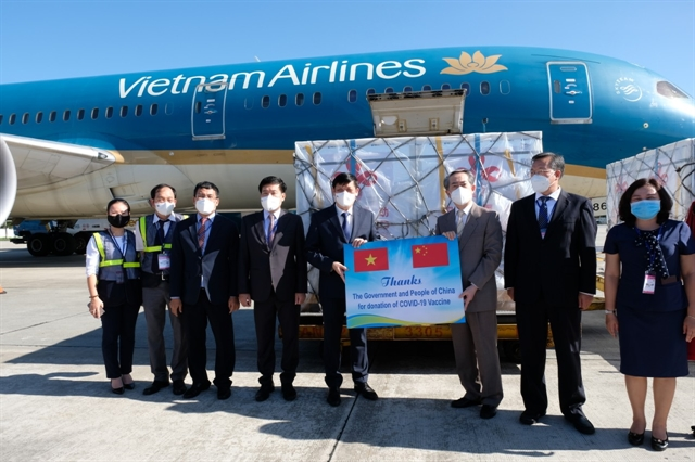 China-donated COVID-19 vaccines and syringes arrive at Nội Bài airport
