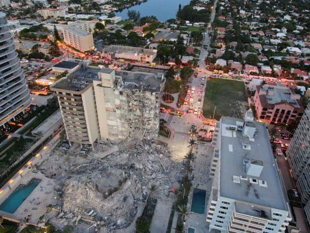 Crews comb rubble of collapsed Florida condo 99 unaccounted for